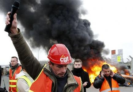 Workers of French oil giant Total and the SFDM Society, and SNCF railway workers block the entrance of the deposit of the society SFDM near the oil refinery of Donges