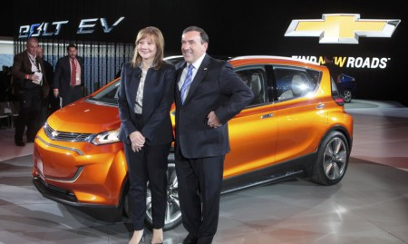 General Motors CEO Barra and Batey President of GM North America pose next to the Chevrolet Bolt EV electric concept car after it was unveiled during the first press preview day of the North American International Auto Show in Detroit