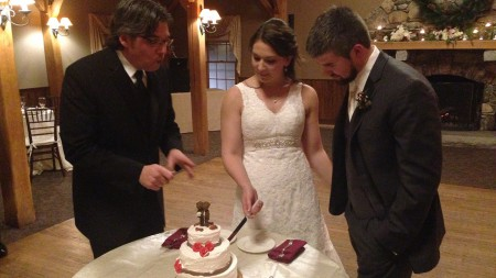 The cutting of the ice cream cake. Because ice cream cake is awesome.