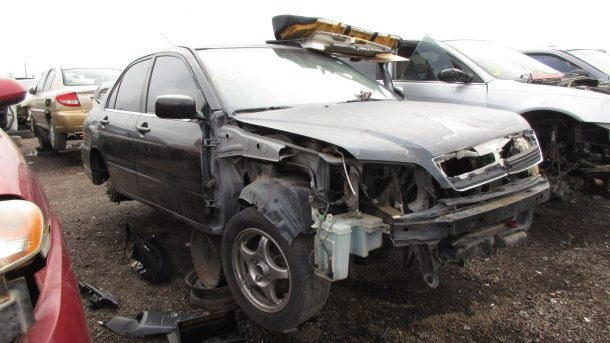 2002 Mitsubishi Lancer OZ Rally in Arizona wrecking yard, RH front view - ©2018 Murilee Martin - The Truth About Cars