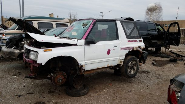 1993 Geo Tracker in Illinois wrecking yard, LH front view - ©2018 Murilee Martin - The Truth About Cars