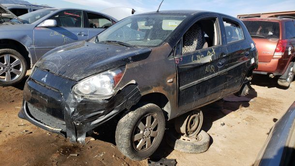 2014 Mitsubishi Mirage in Colorado junkyard, LH front view - ©2020 Murilee Martin - The Truth About Cars