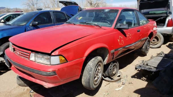 1988 Chevrolet Cavalier in Colorado junkyard, LH front view - ©2020 Murilee Martin - The Truth About Cars