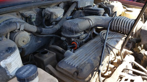 1988 Chevrolet Cavalier in Colorado junkyard, engine - ©2020 Murilee Martin - The Truth About Cars