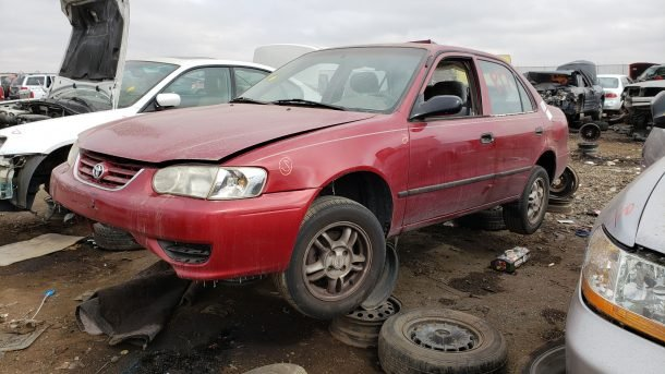 2002 Toyota Corolla CE in Colorado junkyard, LH front view - ©2020 Murilee Martin - The Truth About Cars