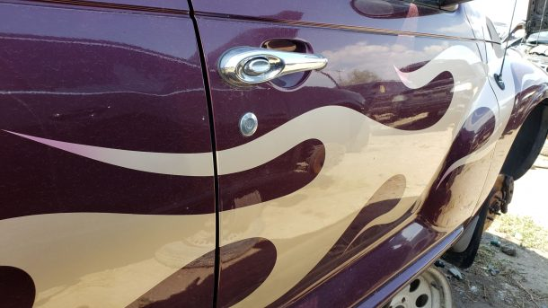 2001 Chrysler PT Cruiser in Colorado junkyard, flame decals - ©2020 Murilee Martin - The Truth About Cars