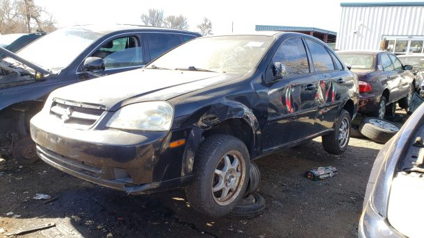 A 2006 Suzuki Forenza in Denver junkyard, LH front view - ©2020 Murilee Martin - The Truth About Cars