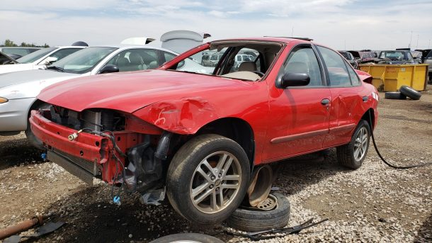 2005 Chevrolet Cavalier in Colorado junkyard, LH front view - ©2021 Murilee Martin - The Truth About Cars