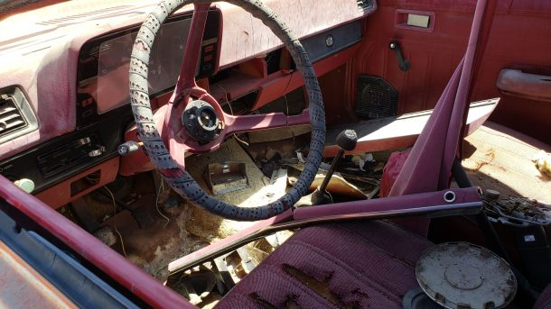 1981 Plymouth Horizon Miser in Colorado junkyard, steering wheel - ©2021 Murilee Martin - The Truth About Cars