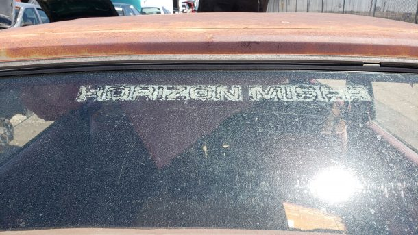 1981 Plymouth Horizon Miser in Colorado junkyard, emblem - ©2021 Murilee Martin - The Truth About Cars